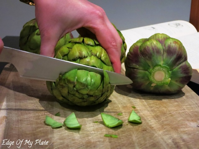 cutting off the tops off the artichokes