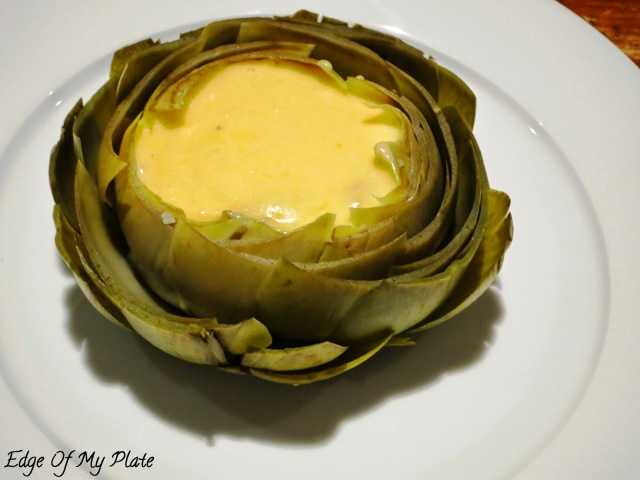 artichoke filled with hollandaise sauce